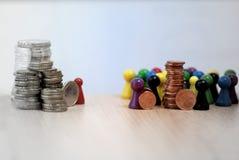 Inequal pengarfördelning i skämtsam bild för kapitalism arkivfoto