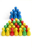Inequality. A group of blue gamefigurines above a group of others - concept inequality, elites royalty free stock photo