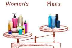 The inequality of male and female cosmetics on the scales. The inequality of male and female care products. Comparison of cosmetics on the scales Stock Photography