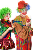 Inequity in the world of clowns Royalty Free Stock Images