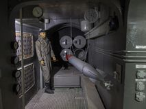 Interior of german submarine. Mock-up of historic german military submarine operated during IIWW. Model of interior of U boat presented in Mamerki museum in stock photos
