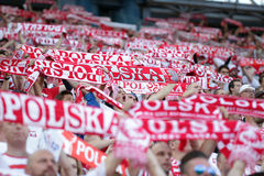 Inernational Friendly football game fans with scarves royalty free stock photos