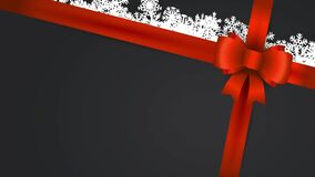 christmas gift adorned with red pull bow
