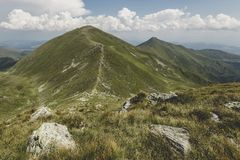 Ineut and Rosu Peaks. Viewed from the main ridge of Rodnei Mountains Stock Photos