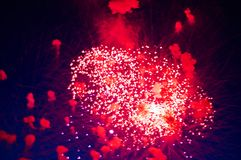 Very cheap firework over the city, red. Inexpensive fireworks, over the city, red. For any purpose Royalty Free Stock Photo