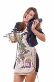 Inexperienced female cook trying to be housewife talking on the Royalty Free Stock Photos