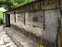 infödd sten för hus Arkivbild