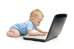 Infant. Using laptop over white Royalty Free Stock Images