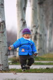 Infant. Waking on the tree roads Stock Photos