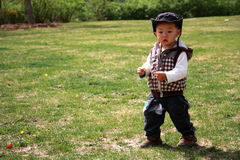 Infant. Is playing in the garden Royalty Free Stock Photo