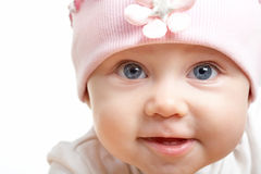 Infant. Face of adorable baby in hat looking at camera Stock Images
