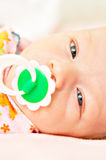 Infant. In diaper with pacifier Royalty Free Stock Images