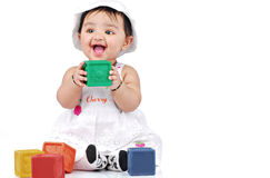 Infant 6-8 month. Baby playing with colourful blocks Stock Photography