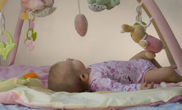Infant on Activity Mat Stock Photo