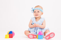 Infant age ten months. On a white background Royalty Free Stock Photos