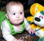 Infant And Her Toy Stock Photo