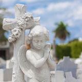 Infant angel with a diffused cemetery background Royalty Free Stock Images