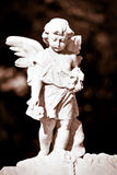 Infant angel in sepia shades Stock Photo