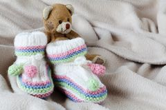 Infant anouncement concept with newborn shoes Stock Photo
