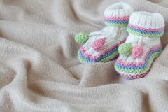 Infant anouncement concept with newborn shoes Royalty Free Stock Photography