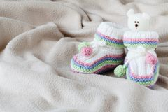 Infant anouncement concept with newborn shoes Stock Images