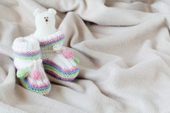 Infant anouncement concept with newborn shoes Royalty Free Stock Image