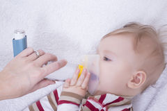 Infant with asthma inhalator Royalty Free Stock Photos