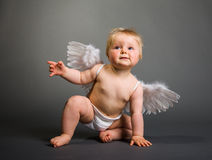 Infant baby with angel wings Stock Photo