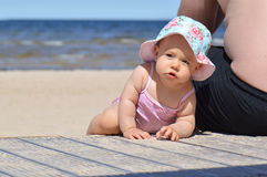 Infant baby on a beach Royalty Free Stock Images