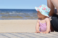 Infant baby on a beach stock photography