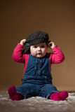 Infant baby with black hat. The first year of the new life Stock Image