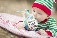 Infant Baby On Blanket With Babys First Christmas Ornament Stock Image