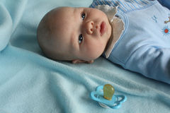 Infant baby boy with a dummy Royalty Free Stock Photos