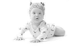 Infant baby boy in pijamas amazed isolated on white Stock Image