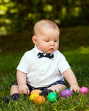 Infant baby boy playing with Easter eggs Stock Image