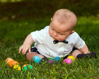 Infant baby boy playing with Easter eggs. Cute infant baby boy playing with Easter eggs Stock Image
