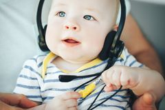 Infant Baby Child Boy Six Months Old with Headphones. Little Baby Child Boy Six Months Old with Headphones stock images