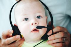 Infant Baby Child Boy Six Months Old with Headphones. Little Baby Child Boy Six Months Old with Headphones stock image