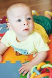 Infant Baby Child Boy Six Months Old is Playing on a Floor Stock Photo