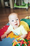 Infant Baby Child Boy Six Months Old is Playing on a Floor Royalty Free Stock Photo