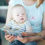 Infant Baby Child Boy Six Months Old is Reading. Little Baby Child Boy Six Months Old is Reading stock photography