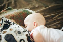 Infant Baby Child Boy Six Months Old is Sleeping at Home. Little Baby Child Boy Six Months Old is Sleeping at Home royalty free stock photo