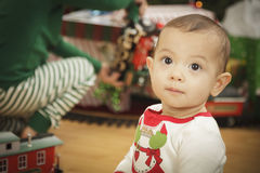 Infant Baby Enjoying Christmas Morning Near The Tree Royalty Free Stock Photography