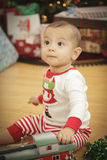 Infant Baby Enjoying Christmas Morning Near The Tree Royalty Free Stock Photos