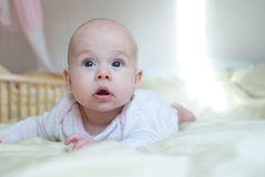 Infant baby girl in bed room Royalty Free Stock Photos