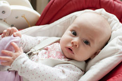 Infant baby girl in children chair Royalty Free Stock Photography
