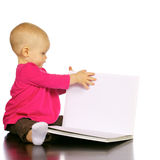 Infant baby girl enjoying and discovering books Royalty Free Stock Photo
