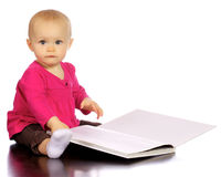 Infant baby girl enjoying and discovering books Royalty Free Stock Images