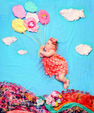 Infant baby girl flying on a helium balloons Royalty Free Stock Photos