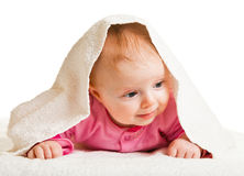 Infant baby girl laying  on whtie Royalty Free Stock Photo